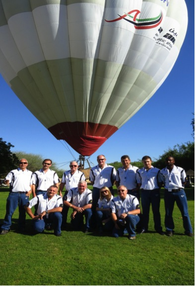 The Team: Rear Standing: Graham Field (Parachutist), Johan von Solms (No 2), Dennis Spence (Owner and Alternate leader), Neil Trollip (No 3), Peter Janse van Rensburg (Good year Aviation), Andrew Nunn (Technician), Jacob Mabulatana (Technician) Front kneeling: Glen Warden (Leader), Albert Hemsted (Team Manager), Amy Shaw (Parachutist), Paul de Villiers (Goodyear Aviation) *Nigel Hopkins (No 4) not present for the pic.